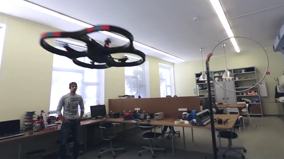 An operator controlling a quadcopter drone, 2015
